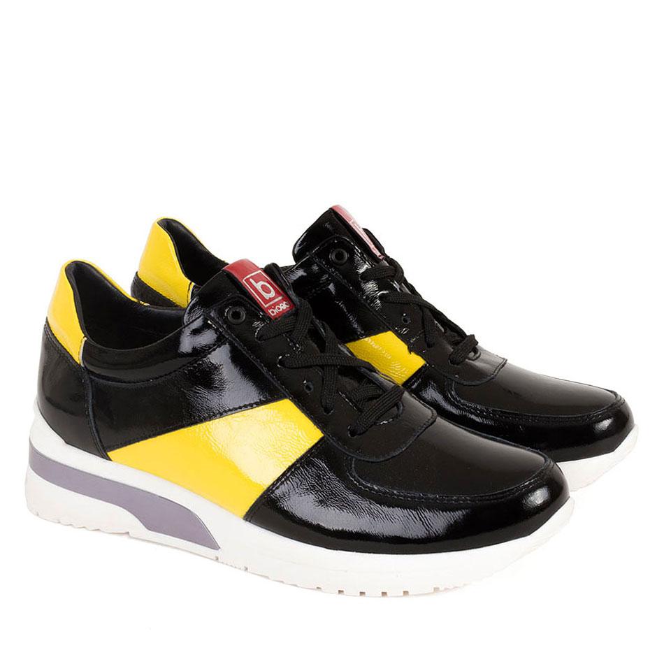 Czarno żółte sznurowane buty na białym spodzie